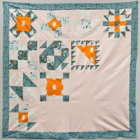 Block of the Month finished quilt top: Warm Colorway