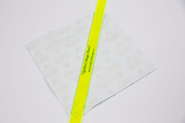 Using the Quilter's Magic wand to mark lines for half-square triangles
