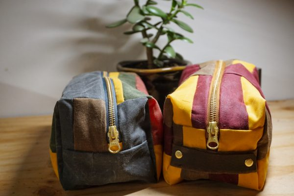 Confident Maker Michael McCollough used his leftover waxed cotton scraps to make these awesome Dopp Kits!
