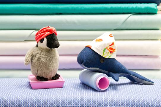 Penguin and Whale showcasing a knit headband and beanie!