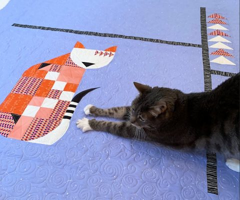 A Kitty Inspecting the Posh Kitty Quilt